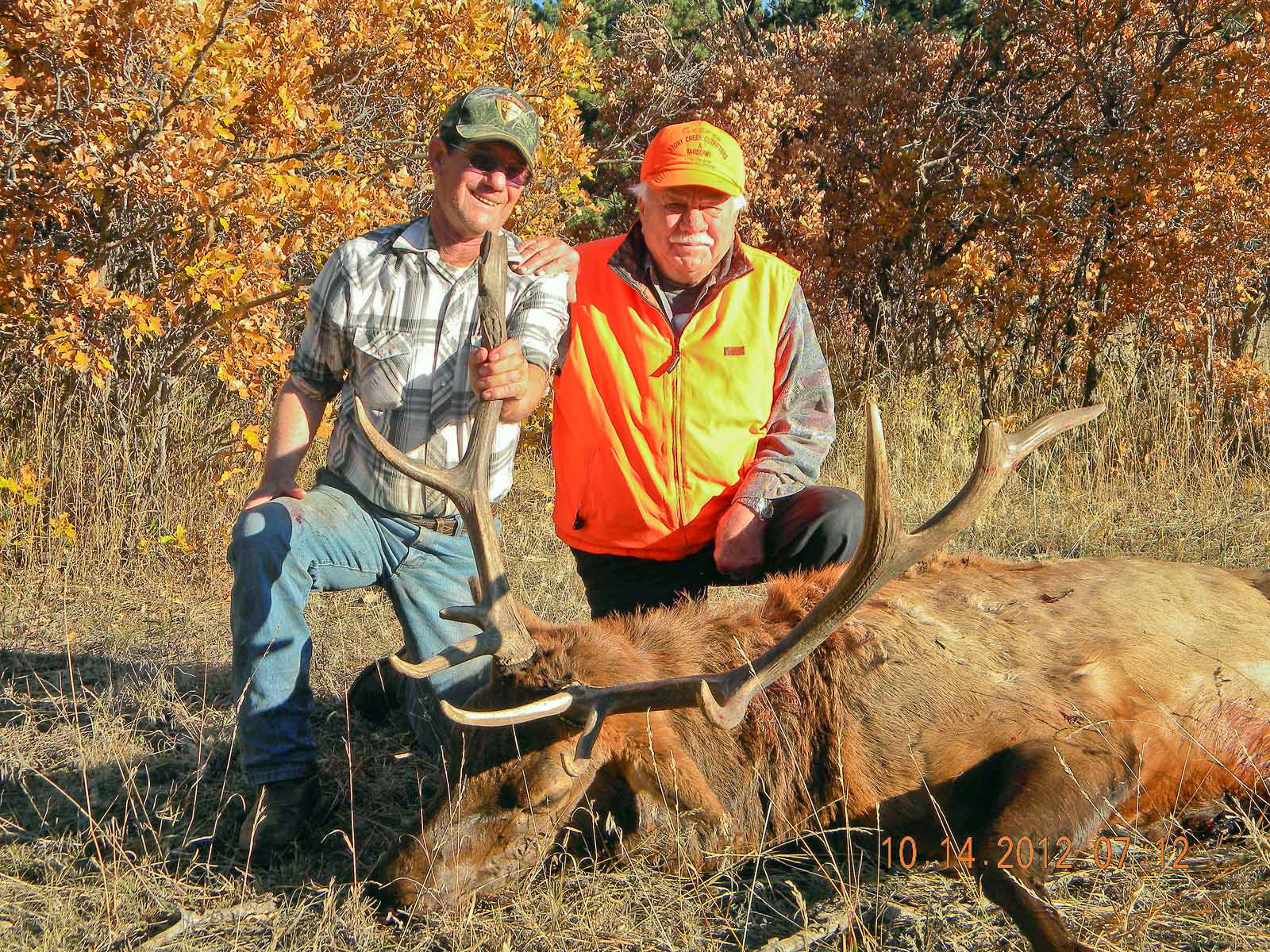 Hunter and guide with a harvested bull elk.